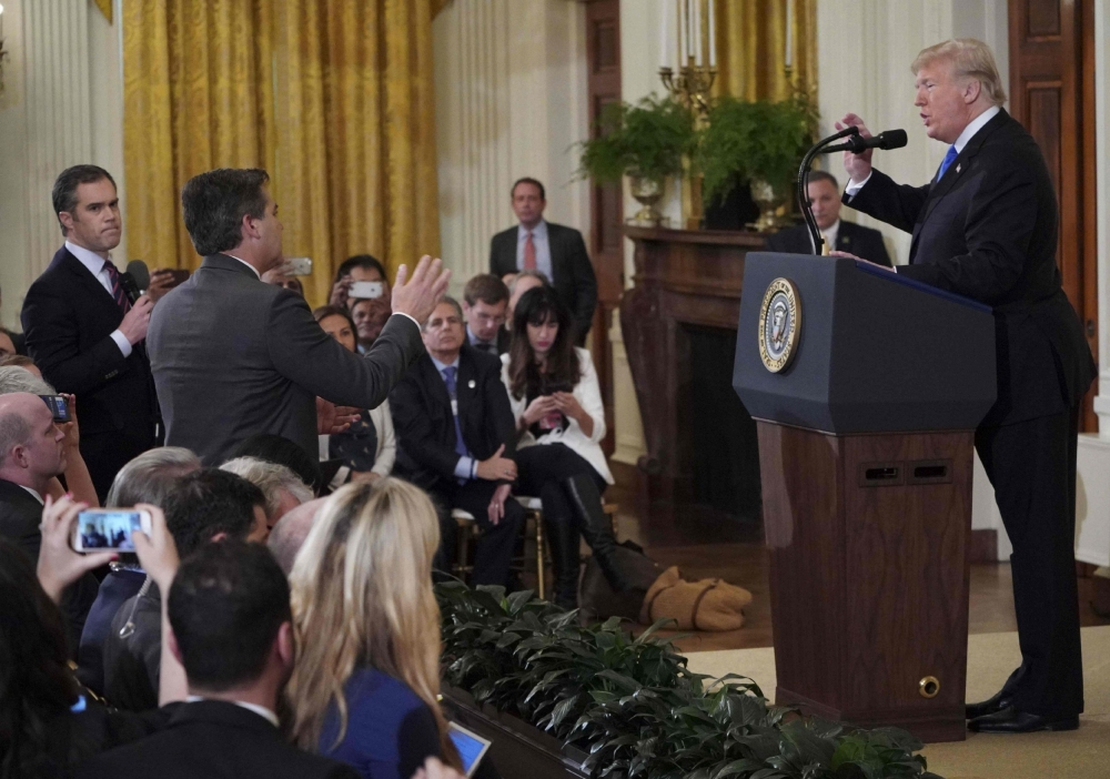 White House suspends credentials for CNN reporter Jim Acosta