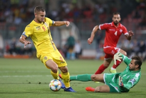 Romania ease past Malta