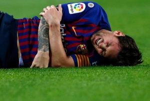 Lionel Messi out for a month with arm injury