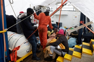 Blankets, socks, shoes and supplies delivered to stranded migrant rescue ship