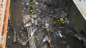 One dead in helicopter crash on New York skyscraper