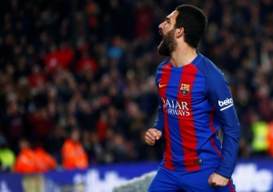 Turkish prosecutor seeks 12-year jail term for Barcelona's Turan