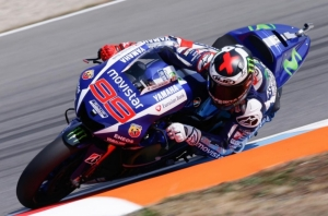 Lorenzo breaks lap record to take pole