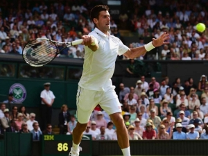 Djokovic brushes Tomic aside