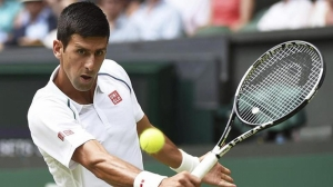 Wimbledon: Novak Djokovic sees off Jarkko Nieminen in three sets