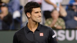 Djokovic advances as Tsonga and Ward crash out