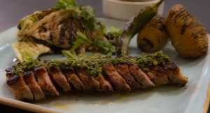 Pork flank with grilled cabbage and chermoula sauce