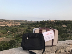 Egrant inquiry: Activists leave suitcases outside PM's summer residence at Girgenti