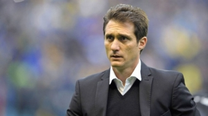 Boca manager Guillermo Barros Schelotto leaves after Copa Libertadores loss