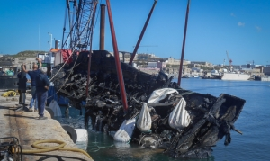 Burnt yacht wreckage recovered from seabed