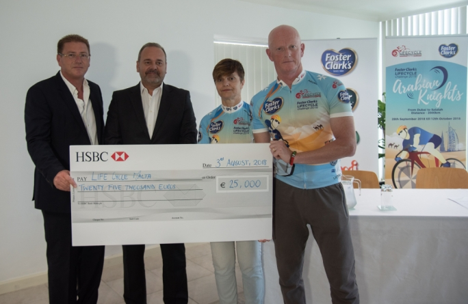 Foster Clark's managing director Mr Joseph Busuttil (left) presenting the sponsorship cheque to LifeCycle's Dr Shirley Cefai and Mr Alan Curry in the presence of Minister Christian Cardona