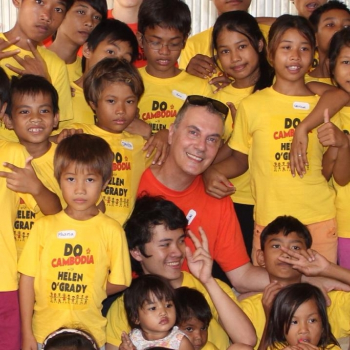 Alan Montanaro with children the NGO he co-founded helps in Cambodia
