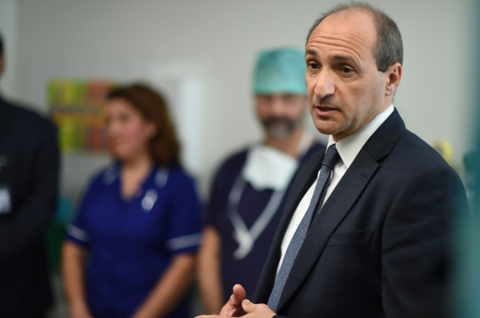 Health minister Chris Fearne has tabled hospital privatisation contracts in the House