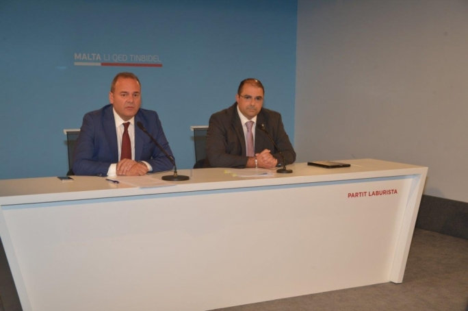 Economy minister Chris Cardona (left) and PL Swieqi councillor Mario Fava (right) address a press conference