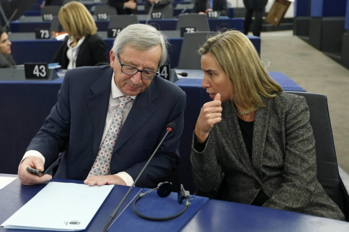EU Commission President Jean-Claude Juncker says the EU needs its own army to send a message to Russia. He is pictured with EC foreign affairs commissioner Federica Mogherini