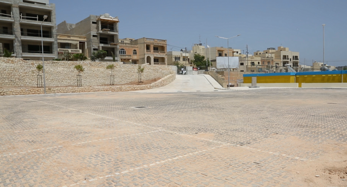 The car park built outside development zones in Marsaxlokk next to the football ground