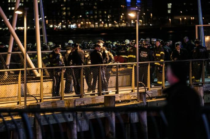 Members of the New York Fire Department at the East River after the helicopter crashed (Photo: NY Times)