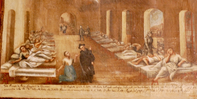 An ex-voto of the Plague of 17 Aug 1813 of Anna Lungaro showing the pest Hospital Valletta. The light house on Fort st Elmo can be seen through the arch where an attendant with a mask around his face is fumigating the foul air. (Sanctuary Our Lady of Mellieha)