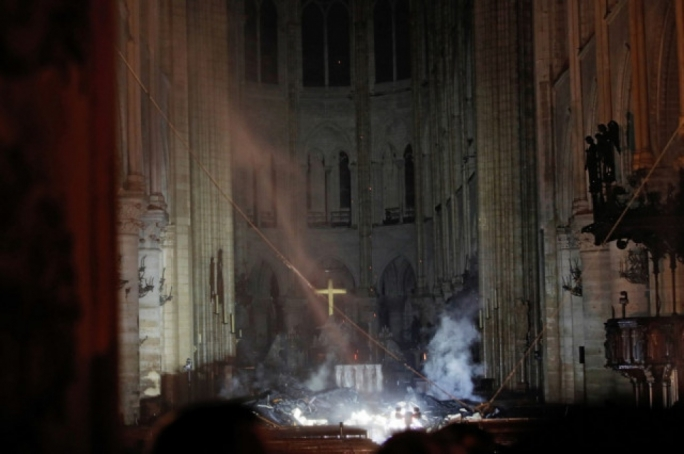 First look inside Notre Dame following fire. The Altar and Cross remain