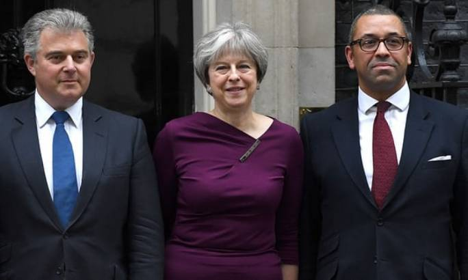 Theresa May poses outside Downing Street with Brandon Lewis (left), new Conservative party chairman and minister without portfolio, and James Cleverly, deputy chairman (Photo: The Guardian)