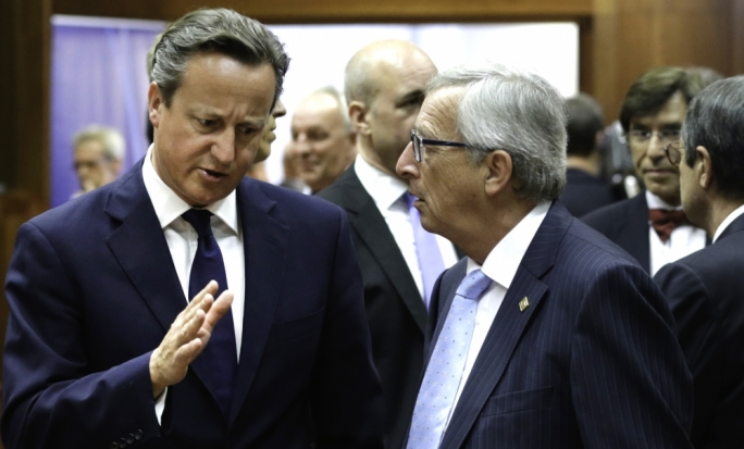UK Prime Minister David Cameron (left) makes a point to European Commission President Jean-Claude Juncker