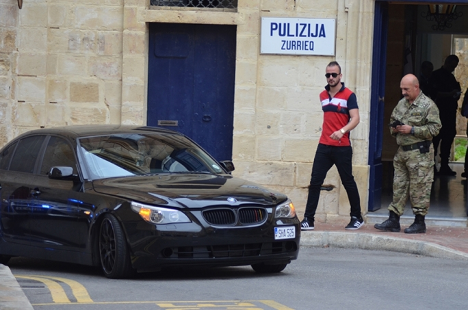 The driver of the BMW coming out of the Police Station.  Photo John Pisani
