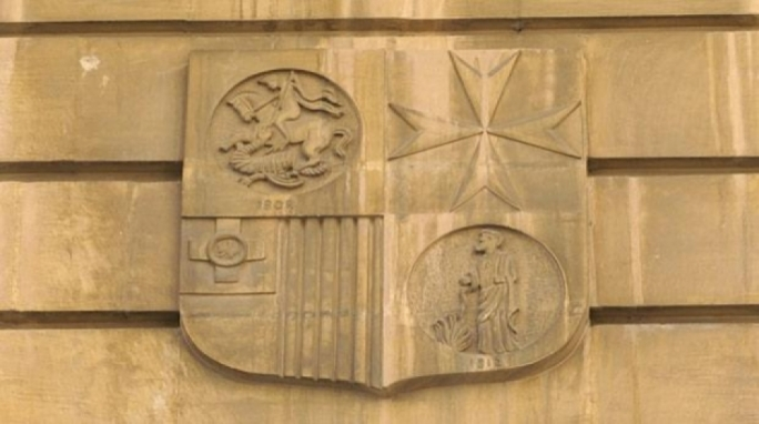 The insignia of the former National Bank of Malta