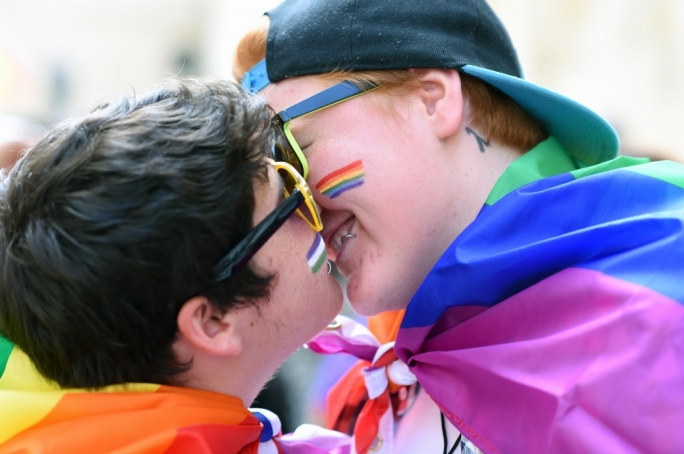 A gay couple embraces at the annual Pride March. Photo: Ray Attard