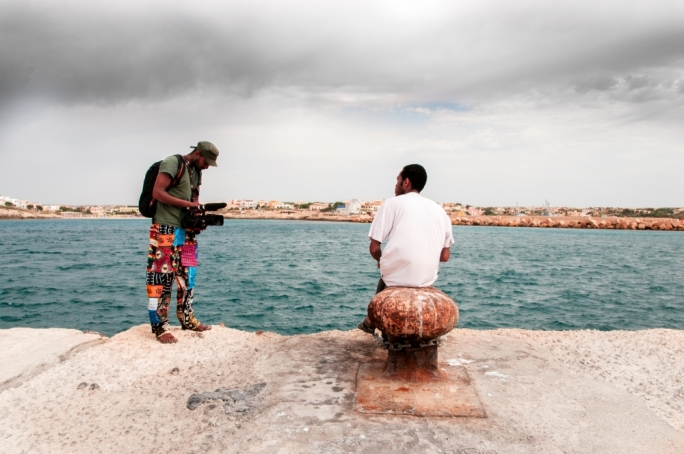 Somali journalist Zakaria Mohamed Ali (centre) retraced his steps to Lampedusa to film a poignant documentary about the migrant experience • Photo by Mario Badagliacca