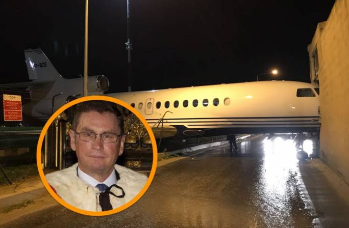 Michael Ashcroft's (inset) private jet lost its security cables and taxied straight off the Malta runway