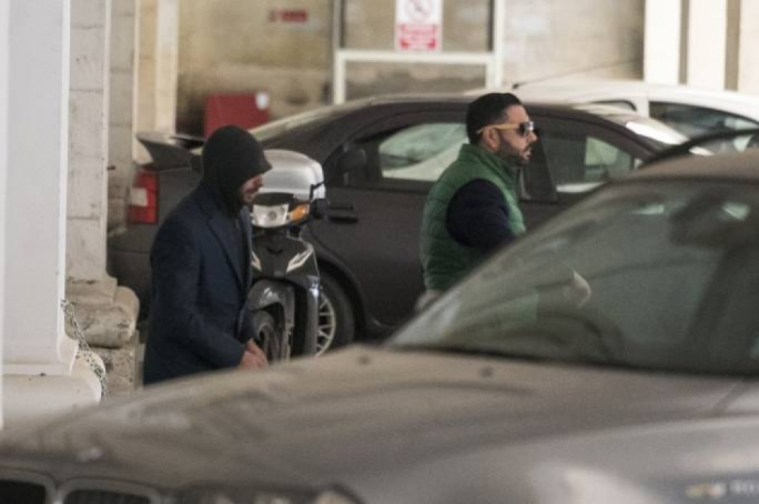 One of the three men charged with the car bomb attack being escorted out of court. Photo: James Bianchi/MediaToday