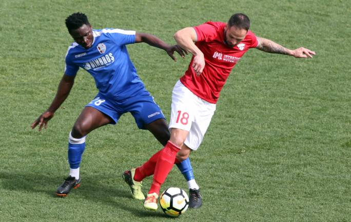 Ismael Karba Bangoura of Mosta challenging Bartulovic Damir for the ball. Photo: Dominic Borg