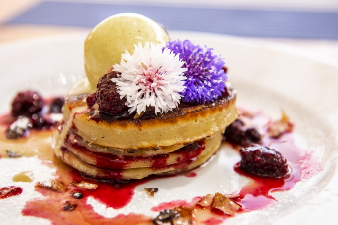 Hot cakes with mixed berries and ice-cream