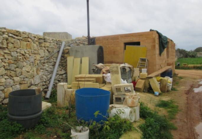 Illegal structures being demolished on site in Hal Safi