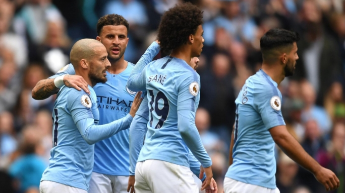 Sane celebrating with team mates after scoring for Manchester City