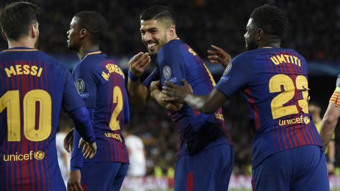 Luis Suarez celebrating with team mates after scoring against Roma