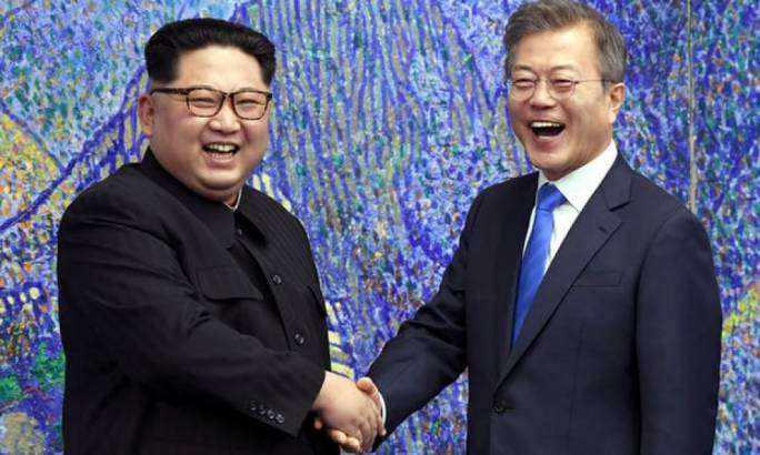 North Korea's leader Kim Jong-un shakes hands with South Korea's President Moon Jae-in