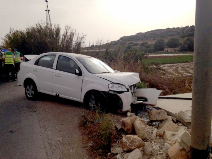 Tourists drive into wall as rain creates slippery conditions