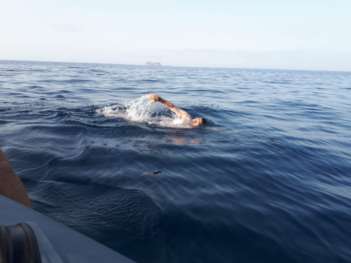 Swimmers take on 70km challenge to raise awareness on plastic waste