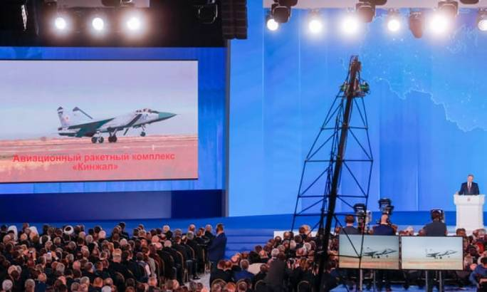 The video screen shows the Kinzhal air missile system during Putin's speech (Photo: The Guardian)