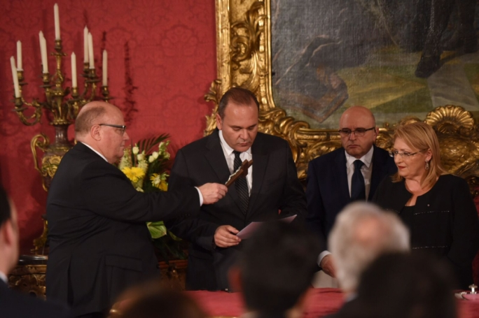 Chris Cardona being sworn in as minister of economy, investment, small business and competition
