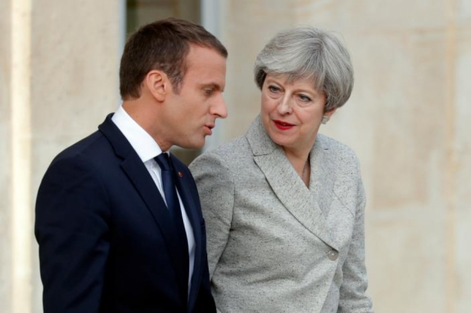 Emmanuel Macron says EU door remains open to Britain as May faces calls to soften Brexit