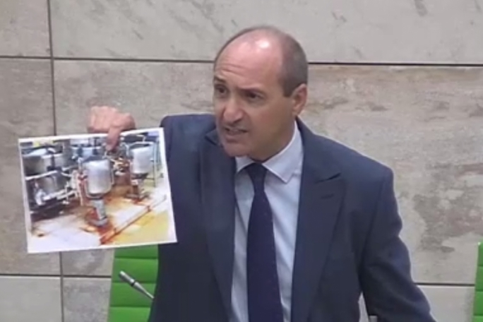 Health minister Chris Fearne shows the House photos of the Gozo hospital's kitchen taken in 2013