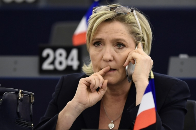 EU lawmakers voted to deprive National Front leader Le Pen of her immunity for the tweeting images of ISIS violence
