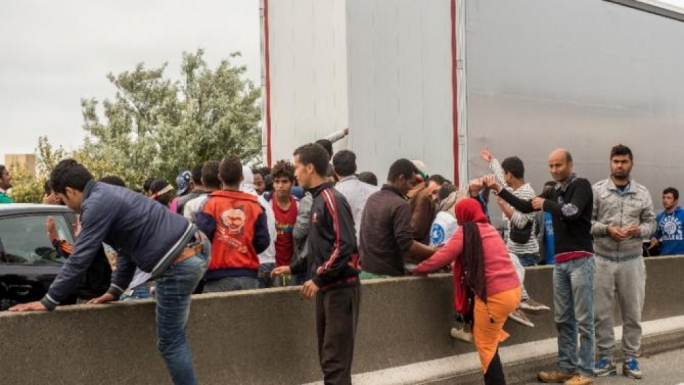 Illegal immigrants cause disruptions at the Channel Tunnel in Calais to try to gain passage into the UK