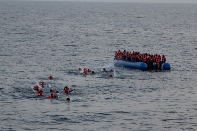 Refugees swim away from the Libyan coast guard, according to a photo posted by Sea Watch, on the 21 April. Photo: Tim Lüddemann/Sea-Watch.org