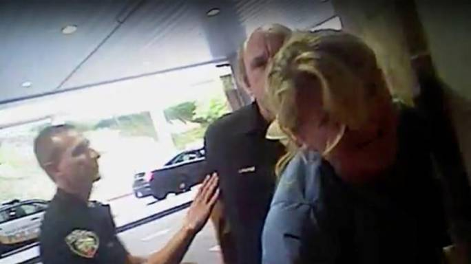 Police roughed up a nurse after she refused to draw blood from an unconscious patient