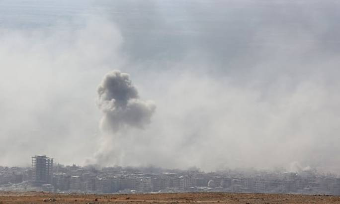 Smoke rising from the rebel-held town, Douma. (Photo: The Guardian)