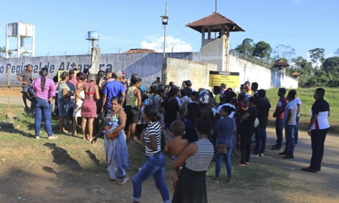 People seek information about family members who are prisoners after a riot inside the Regional Recovery Center in Altamira, Brazil