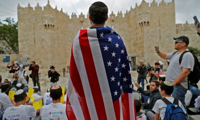 An Israeli man draped in the stars and stripes at Damascus gate in Jerusalem during a protest on Sunday (Photo: Getty Images)